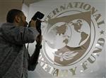 Le fmi abaisse ses prévisions de croissance