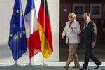 Hollande et merkel adoptent un ton de fermeté envers la grèce