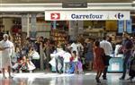 La lente mue de l'hypermarché Carrefour version Georges Plassat