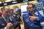 Wall Street : Wall Street finit en hausse avec les fusions-acquisitions