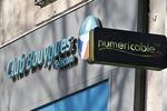 Numericable s'envole en Bourse, Bouygues chute