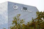 Marché : Total affiche des résultats trimestriels en baisse