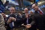 Wall Street : Wall Street clôture en hausse grâce aux fusions-acquisitions