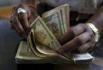 Marché : L'Inde, prudente sur la croissance, baisse ses taux une 3e fois