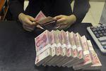 Marché : La Chine dévalue le yuan après des indicateurs décevants