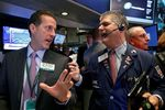 Wall Street : Wall Street pénalisée par les résultats et la politique US
