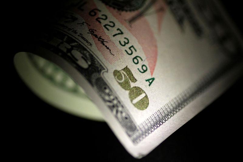 Wall Street finit en baisse, affaiblie par le ton de la Fed
