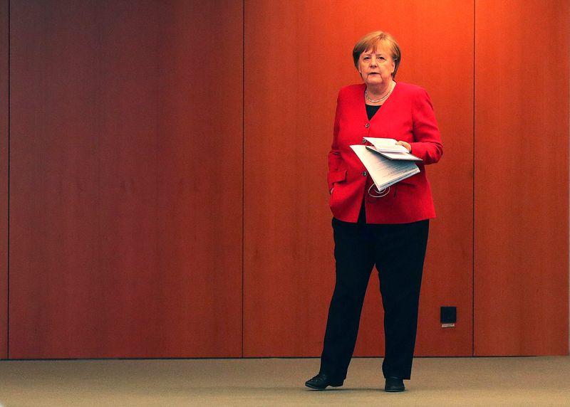 Marché: Merkel juge que le différend BCE-Allemagne peut être régl